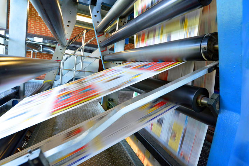 printing machine roll offset in a newspaper printing company